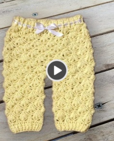 Crochet baby pants with floral pattern
